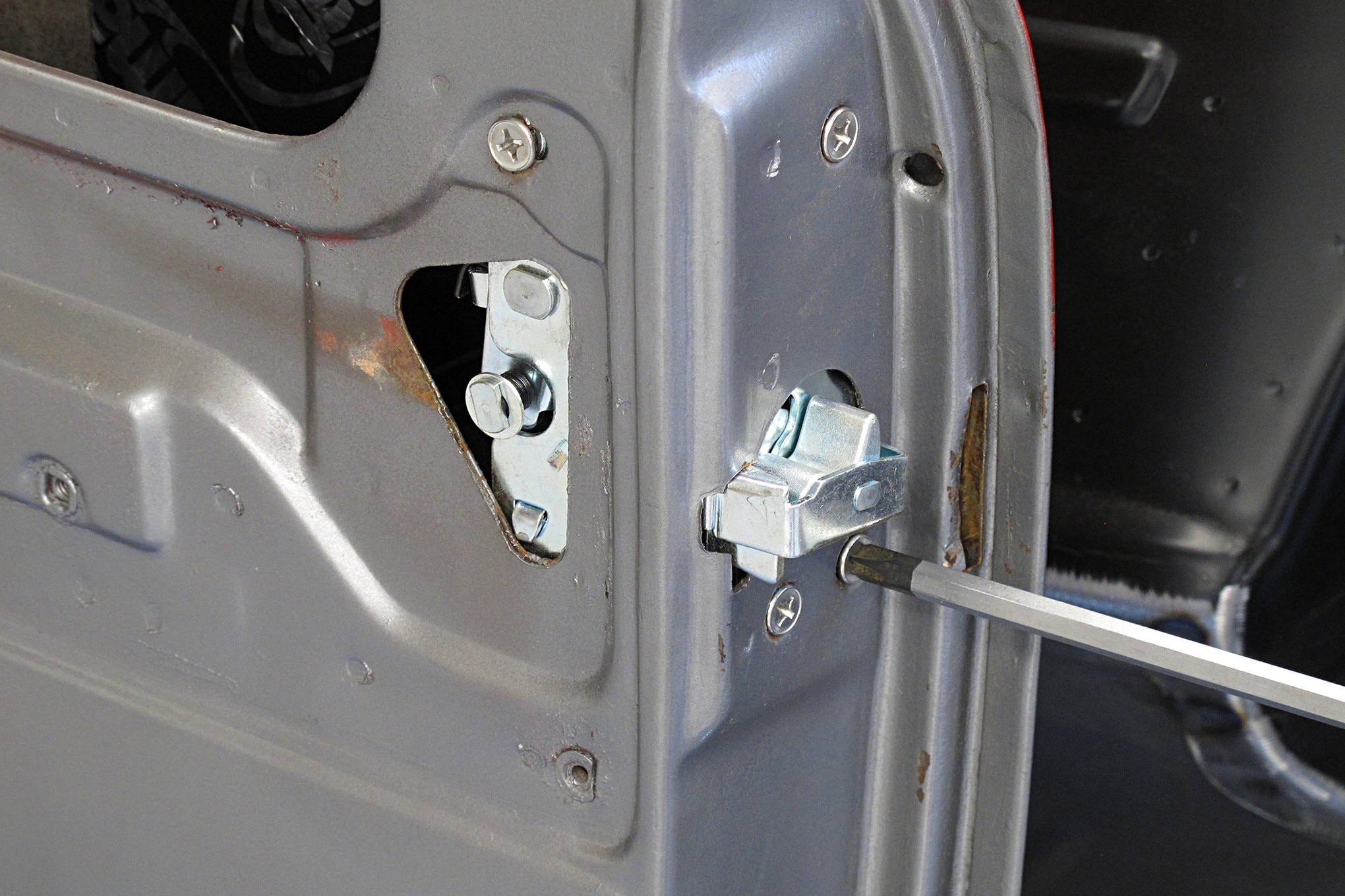 OEM-style replacement screws were used to secure the new latches to the doors.