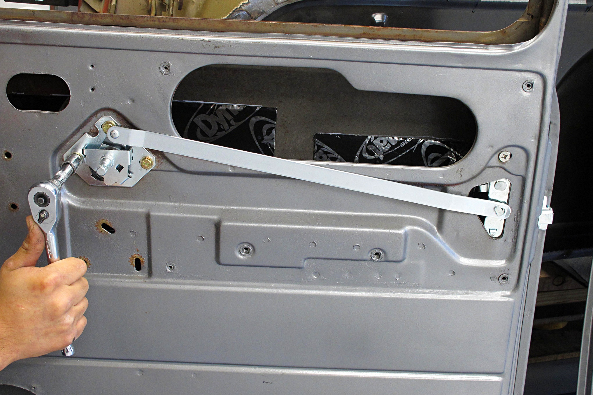 With the all the actuating hardware in place the doors operate like new, and several rattles are usually eliminated.