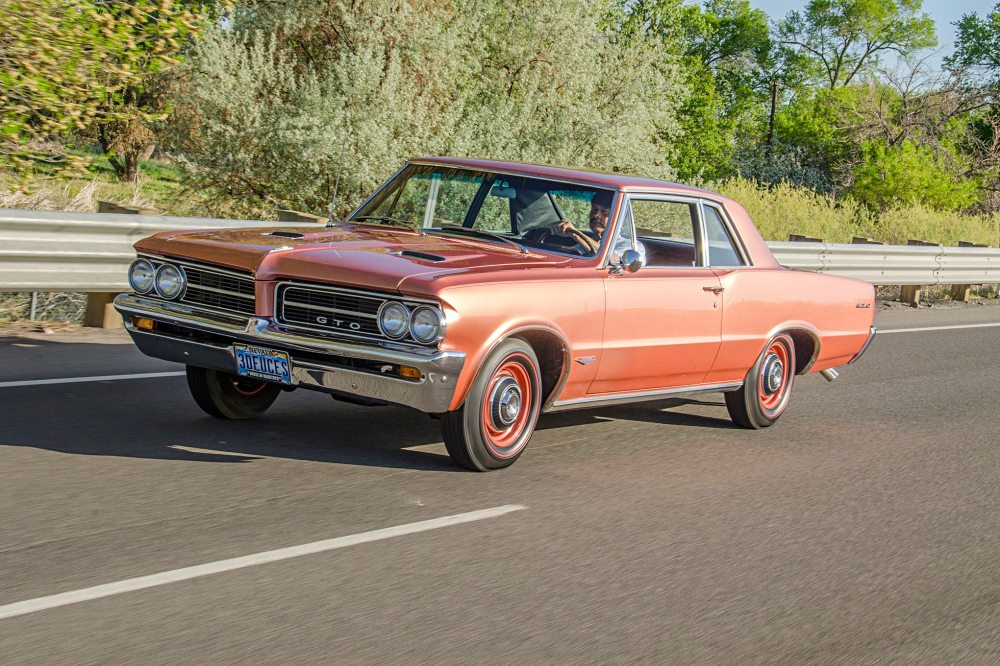 medium resolution of reliving his youth behind the wheel of a rare sunfire red 1964 pontiac gto