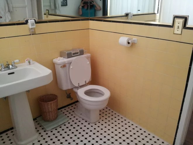 1940s Bathroom Remodel old in yellow  new in blue black and white