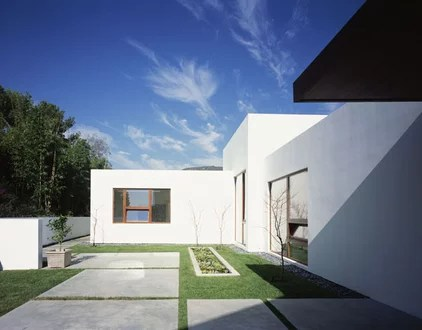 small stucco homes and landscape