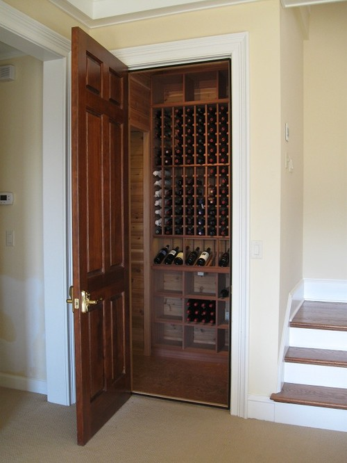 traditional wine cellar by Robert Bass- Kessick Wine Cellars