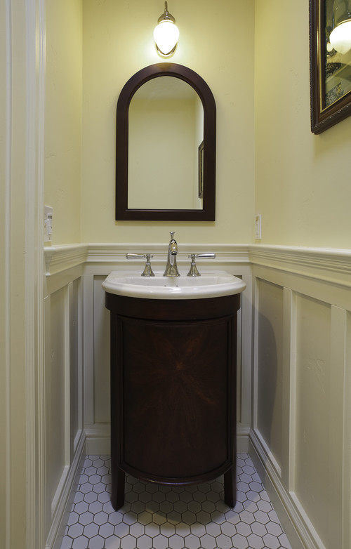 A growing family traditional powder room
