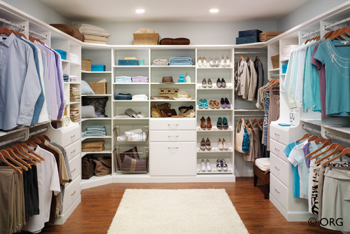 heres a simple contemporary closet the white shelving really makes the colors from the clothes stand out - Closet Design Ideas