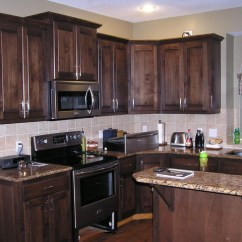 Black Pull Handles Kitchen Cabinets Commercial Floor Mats Cabinet Refacing In A Mediterranean Stain ...