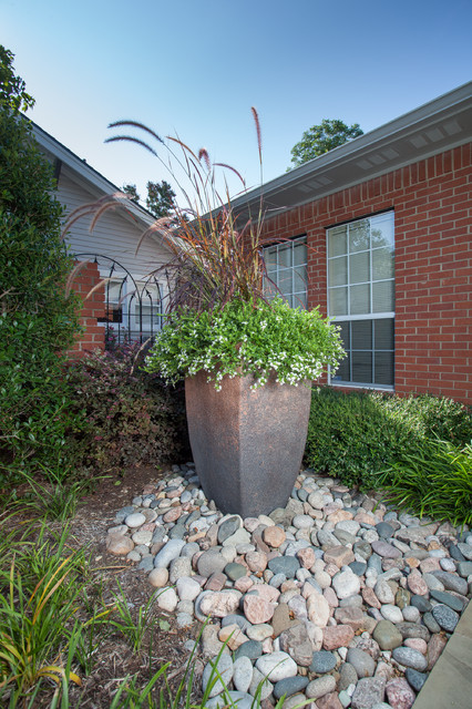 large planters with river rock