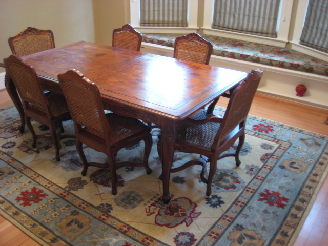 Traditional Dining Room With Tibetan Area Rug