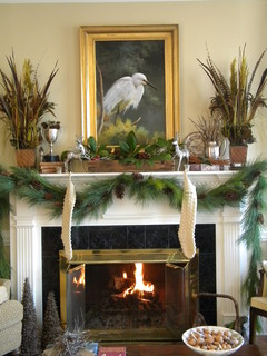 A mantel with a nature inspired garland theme.
