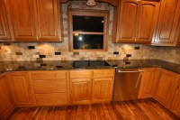 Uba Tuba granite countertop with a Scabos tile backsplash