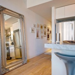 Decorating With Large Mirrors Living Room Country Furniture Sets Designer Tips For A Huge Mirror Has An Impressive Size That Demands Attention To Any It Is Great Statement Piece In The