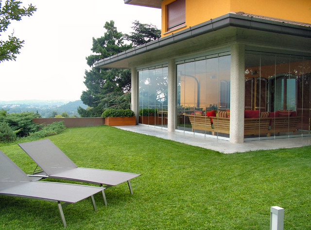 Patio closed off with folding glass doors, water and airproof