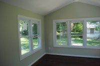 Sunroom with Vaulted Ceiling and Laminate Floors