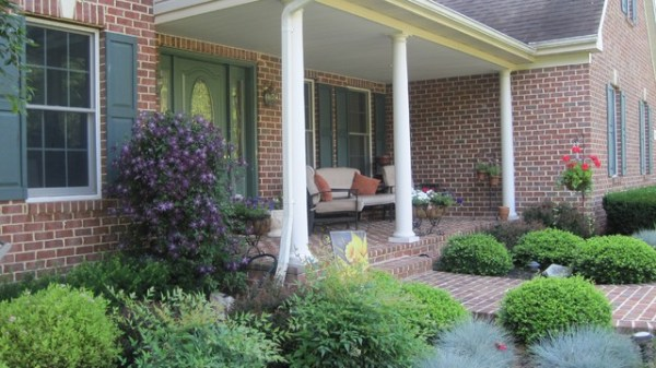 brick front porch with colorful