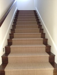 Custom wool runner on wood stairs by carpet boutique