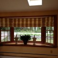 Hobbled roman shade for bay window traditional living room