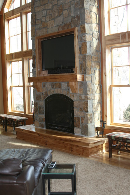 pictures of living rooms with stone fireplaces chairs room tall fireplace