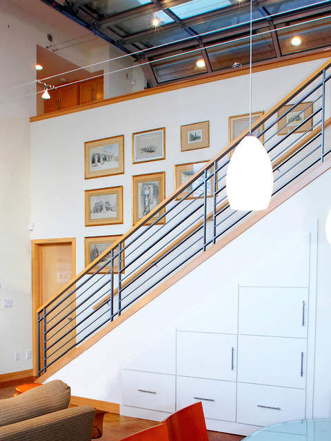 Stair to lower level with storage cabinets below. beach-style-staircase