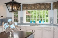 Glass tiled kitchen with Robin's Egg blue strie walls