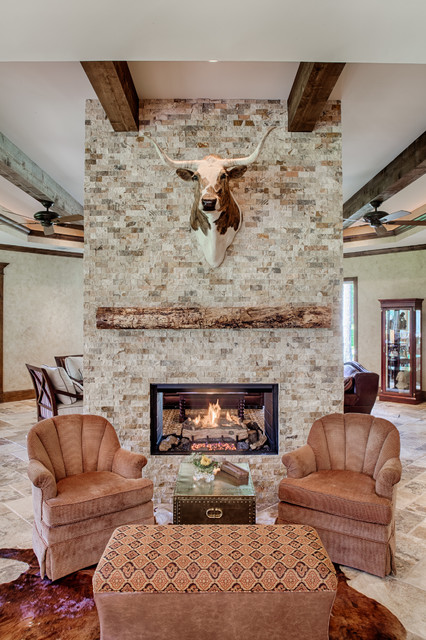 Cowgirl Renovation Rustic Living Room Houston By By Design Interiors Inc