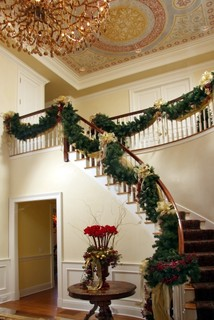 A staircase decorated with beautiful artificial garlands.