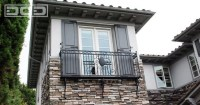Custom French Door Architectural Shutters Atop a Iron