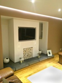 A modernised inglenook fireplace, filled with whitewash ...