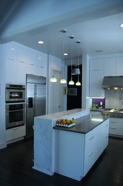 Gloss white cabinets from Plain  Fancy Custom Cabinetry
