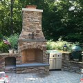 Grand rapids fireplace outdoor kitchen and pool traditional patio