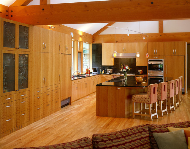 Kitchen of slab wood cabinets with large center island  Contemporary  Kitchen  minneapolis