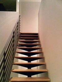 open steel staircase, floating hickory treads, blackened ...