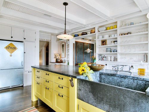 Statement Sink from Soapstone Paired with Yellow Cabinets and Accents Pendant Light Hardwood Flooring White Kitchen