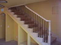 Traditional maple staircase with iron balusters ...