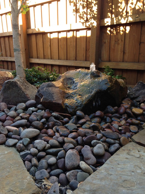 river-rock beds & natural hardscaping