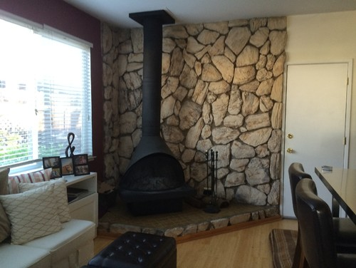 Removal of 1970s Faux RockLava Stone Wall behind Fireplace
