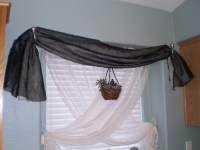 How to keep window scarves from sagging in sconces