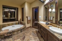 Water tower inspired home master bath suite - Rustic ...