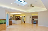 Family room w/ vaulted ceiling skylight opens to kitchen ...