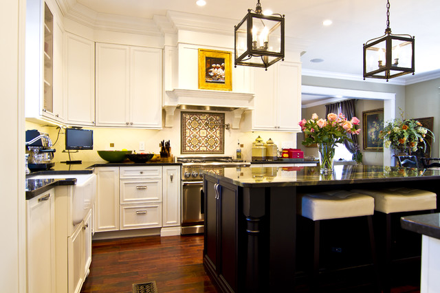 Kitchen in White with distressed dark island  Traditional
