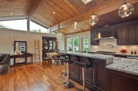 Kitchen with wood paneled ceiling and skylight ...