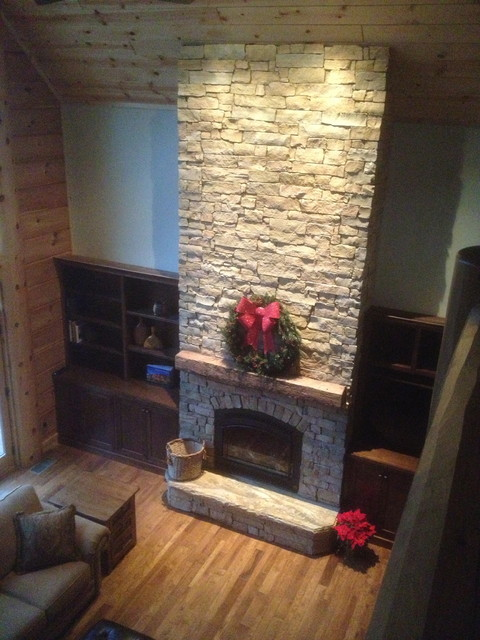 Cathedral ceiling , stone fireplace, custom barn beam