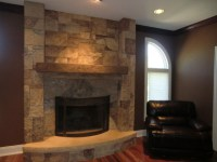 Ann Art Faux Finishes / Cement fireplace over white brick