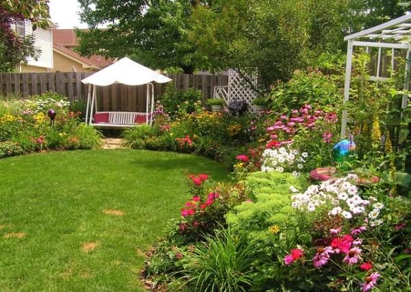 backyard swing in perennial garden