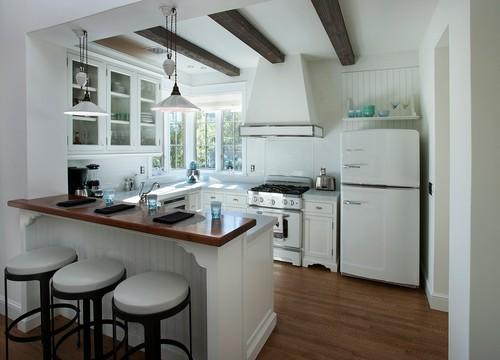 Traditional Kitchen by Phoenix Architects & Designers Candelaria Design Associates