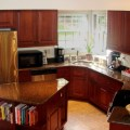 Kitchen renovation with island and angled peninsula traditional
