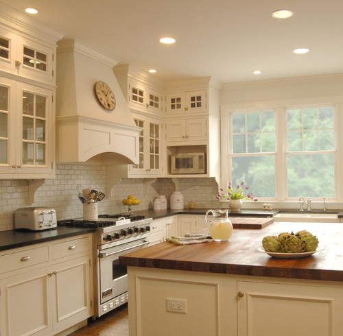 cream kitchen with islands Medium brown cabinets - glazed cream island and hood???