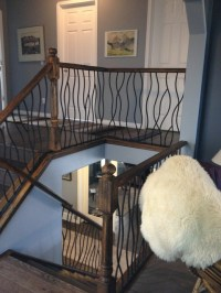 BENT iron design interior railing with a distressed wood ...