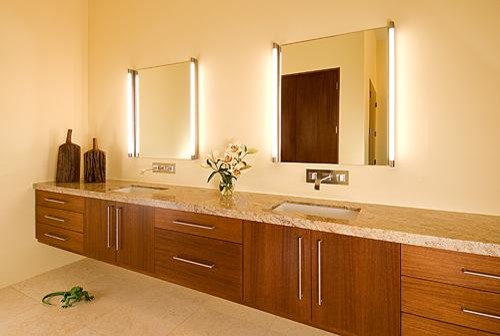 Are vertical vanity lights attached to mirror or separate