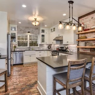 brick floor kitchen window valance ideas design houzz inspiration for a large farmhouse u shaped and red remodel in