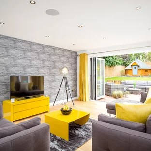 grey yellow living room ideas side tables for white and photos houzz large contemporary enclosed in gloucestershire with walls light hardwood flooring a