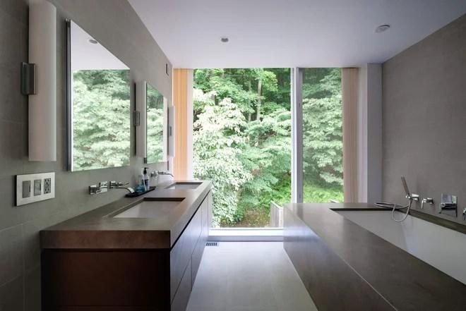 Moderna del cuarto de baño por Fivecat Estudio |  arquitectura